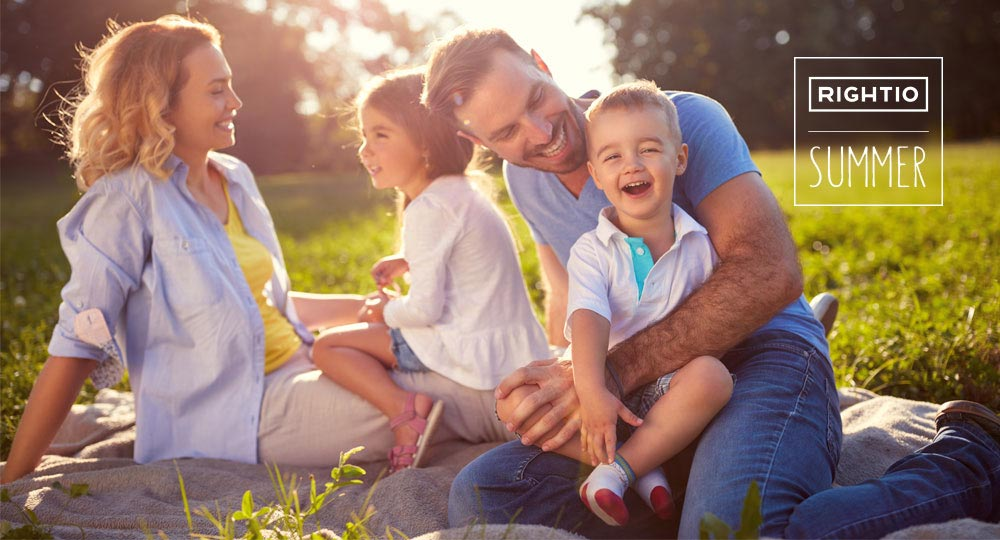 family sitting on grass on a sunny day