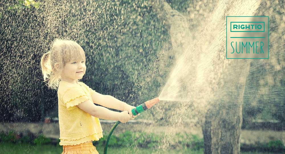 child playing with water hose in Sheffield