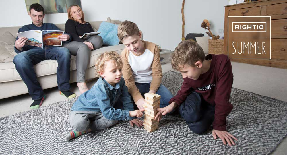 children playing in living room while parents watch from sofa in Edinburgh