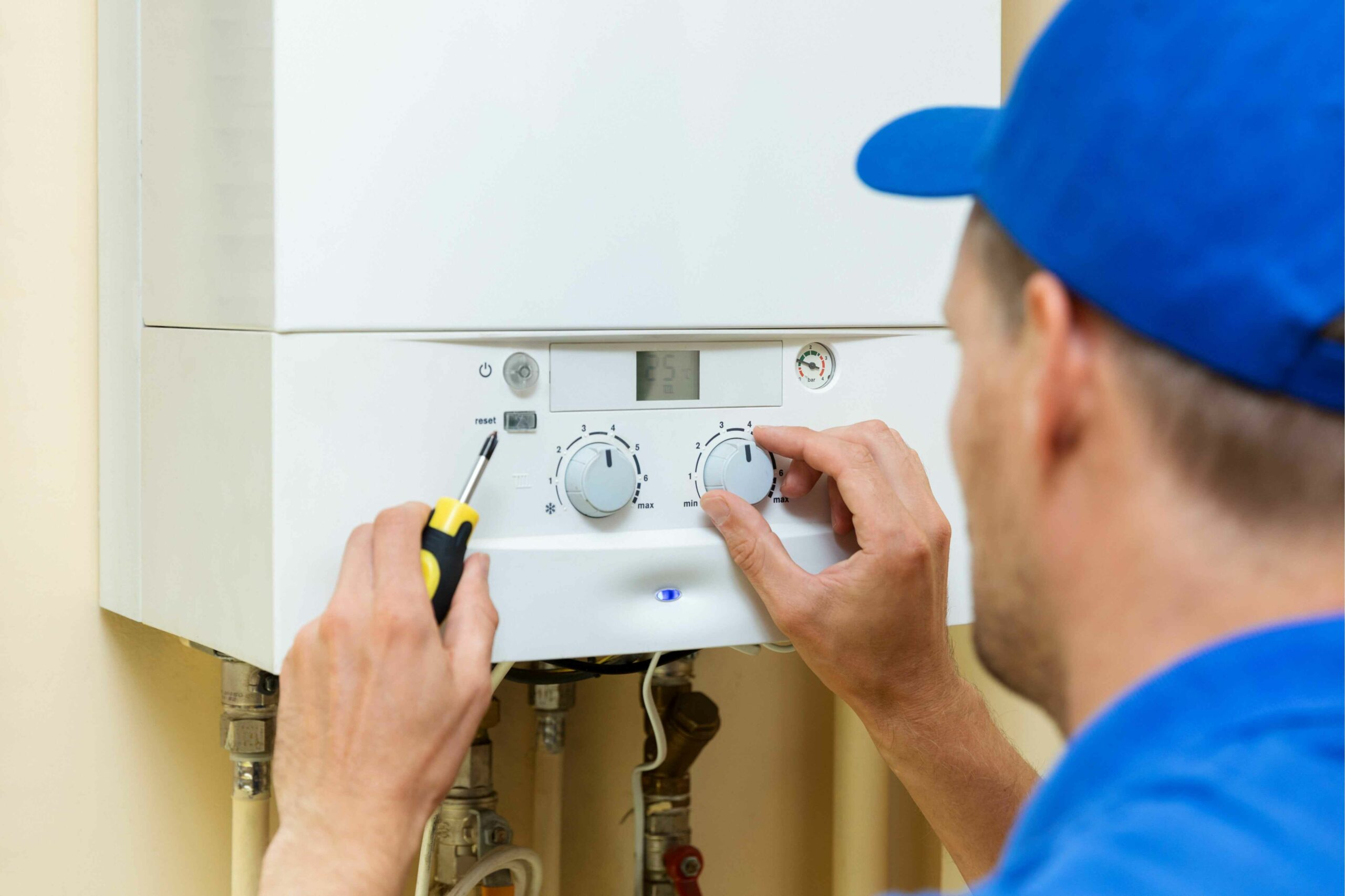 Engineer servicing boiler in Leicester