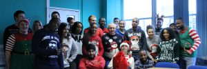 staff photo of everyone wearing christmas jumpers