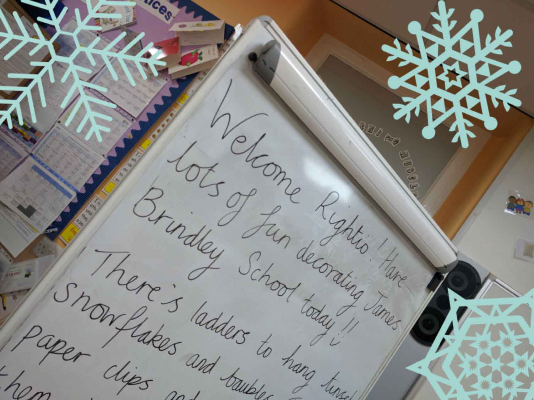 white board in school classroom surrounded by snowflakes