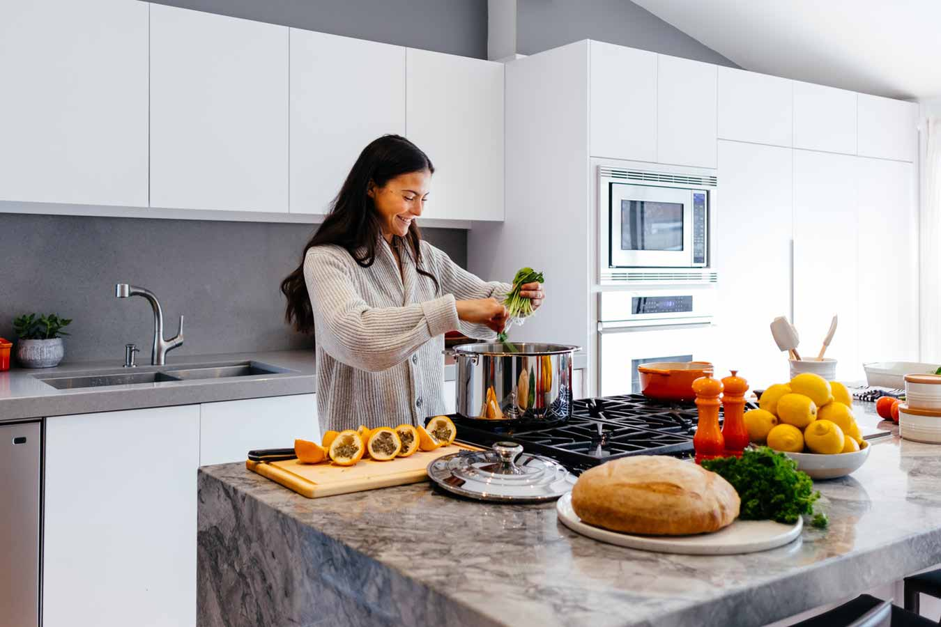 woman in modern style kitchen cooking
