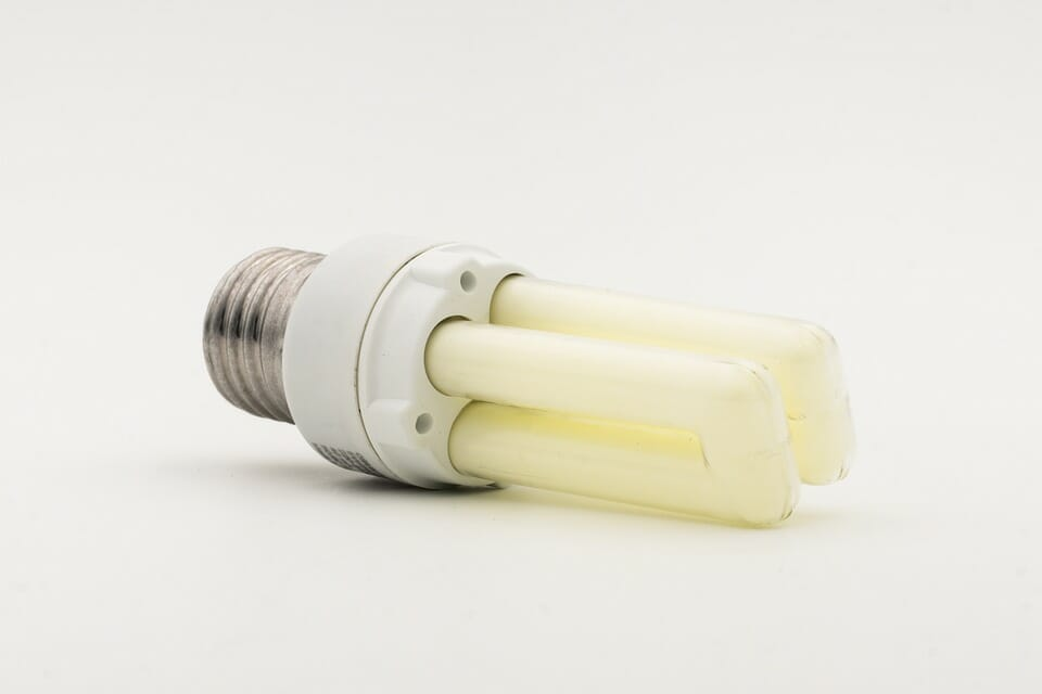 Energy saving led light bulb on white background in Glasgow