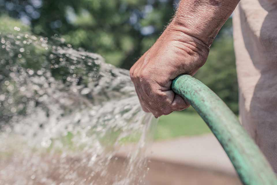 consider installing an outdoor tap for your garden hose
