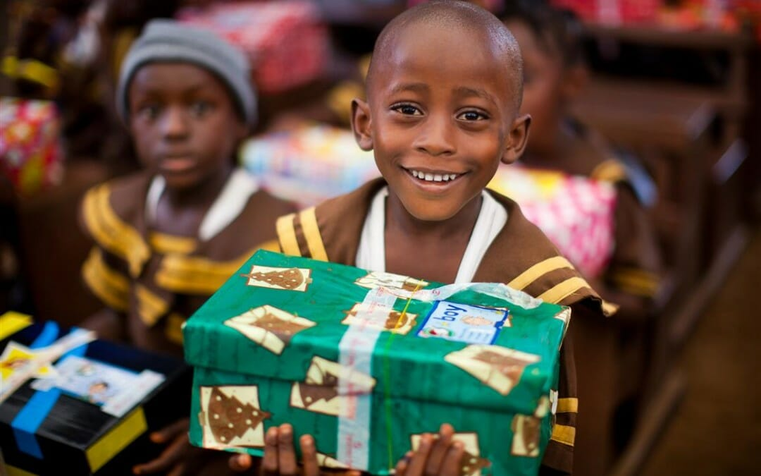 child with christmas present