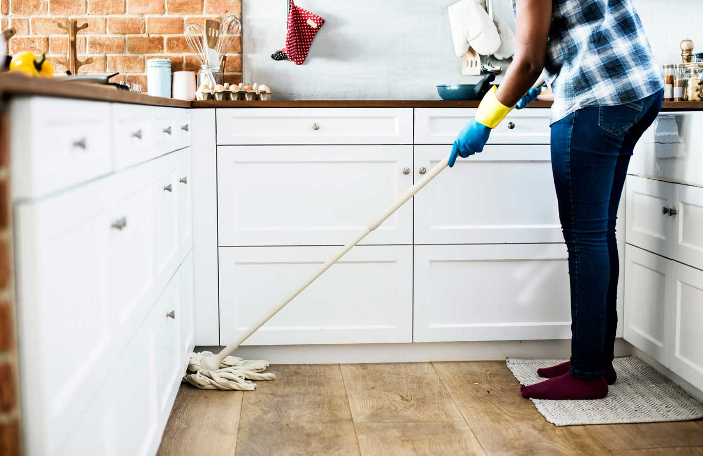 woman mopping for spring cleaning