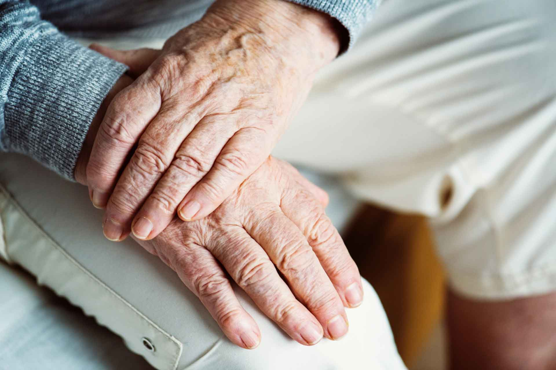 Hands of an elderly vulnerable person