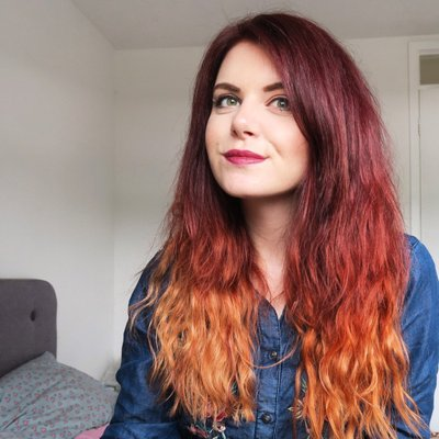 photo of red haired woman in her bedroom